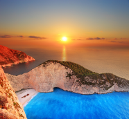 Shipwreck beach at sunset on Zakynthos island, Greece. Photo by Ljupco Smokovski