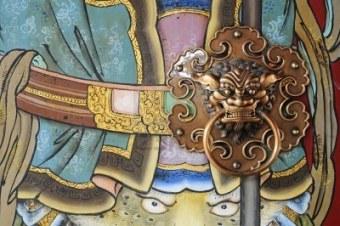 6050095-door-god-of-chinese-temple-and-door-handle from us.123rf (dot) com