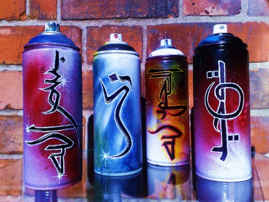 Spray cans with Arabic name tags on it